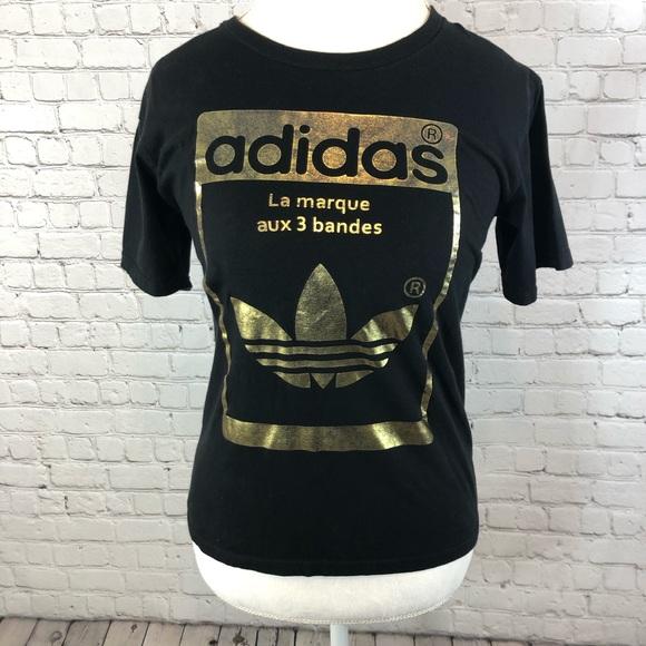 eb856521e7f Adidas La Marque Aux 3 Bandes Gold & Black Shirt